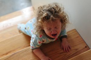 screaming toddler on stairs-strong willed child