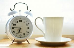 alarm clock and coffee - morning routine checklist